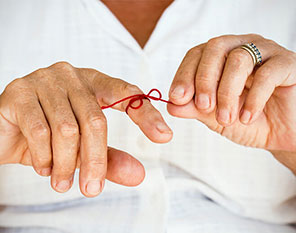 ribbon tied on finger