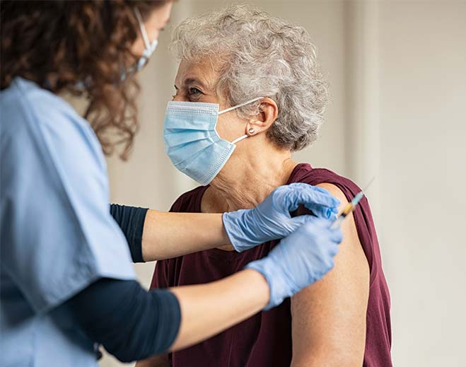 elderly lady getting vaccine